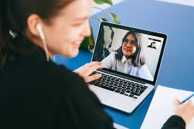 image of woman on a video call on her laptop